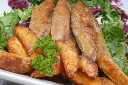 grilled potato: smoked mackerel fillets with grilled potato wedges