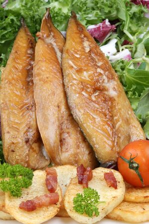 smoked mackerel fillets with fried potatoes and tomato
