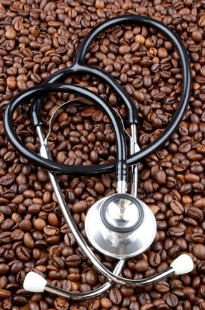 freshly roasted coffee beans and a stethoscope photo
