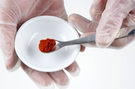 examined: Paprika powder is examined in a food laboratory Stock Photo