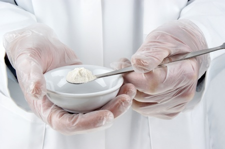 white powder is investigated in the food laboratory Stock Photo