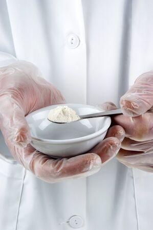 white powder is investigated in the food laboratory Archivio Fotografico