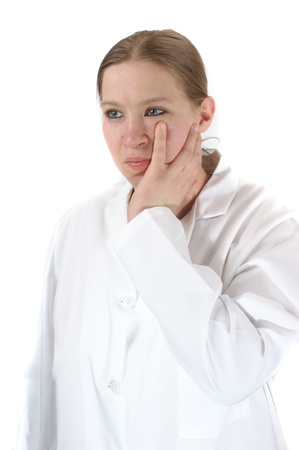 medical assistant: young medical assistant in a white uniform is thoughtfully Stock Photo