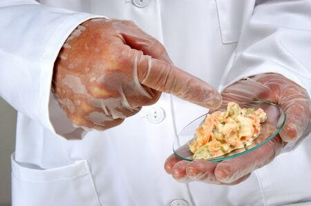 Vegetable salad with mayonnaise is investigated in the food laboratory photo