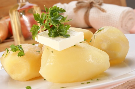 Parsley and butter on boiled potatoes Stock Photo - 10024585