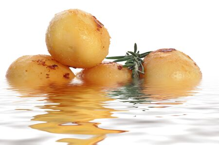 roast potatoes with rosemary on a water bed Stock Photo - 10363668