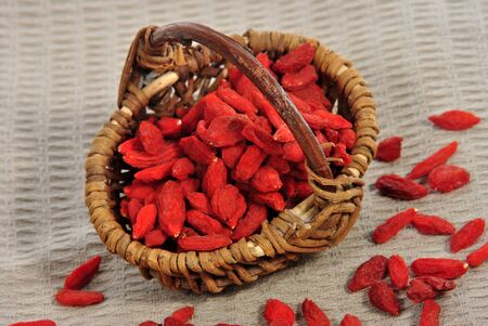 some Goji berries in a small brown basket Stock Photo - 10415583