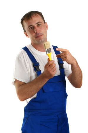 Craftsman with a yellow paintbrush in his hand photo