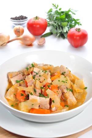 Cabbage soup with carrots, pork meat, potatoes and fresh herbs Stock Photo - 10620633