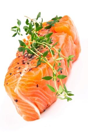 Salmon steak with thyme on a white background photo
