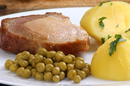 roast pork with boiled potatoes and peas Stock Photo - 10718704