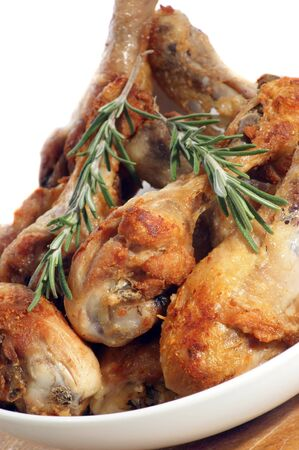 grilled chicken legs with rosemary in a white bowl Stock Photo - 10718711