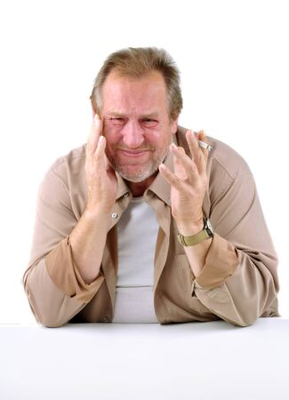 horrified man in his 50s sitting at a table with a cigarette Stock Photo - 10742068
