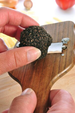 slicer: summer truffle is prepared with a truffle slicer Stock Photo