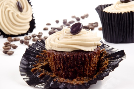 homemade coffee cupcakes and coffee beans in the background Archivio Fotografico