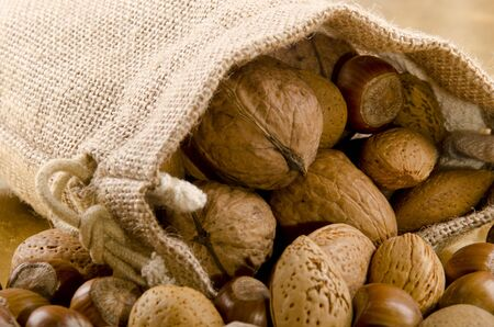various nuts in a brown jute bag photo