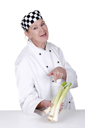 female chef shows with her index finger on leek Stock Photo - 11226971