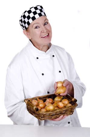 female chef holding a basket with onions in her hand photo