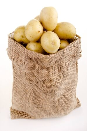 baby potatoes in a small jute bag Standard-Bild