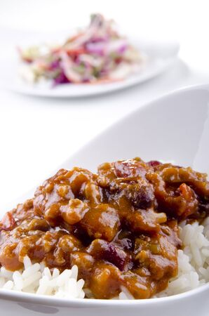 Chilli con carne with basmati rice and some salad in the background photo