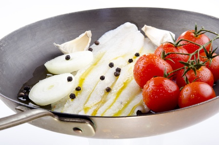 plaice:  Plaice in a copper pan with tomato and onion