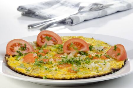 omelette with carrot and tomato on a plate