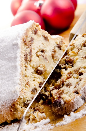 Christmas cake with raisins and sprinkled with icing sugar  photo