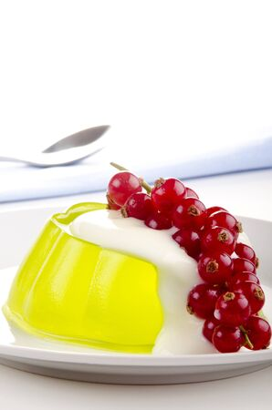 red currants: yellow pudding with red currants