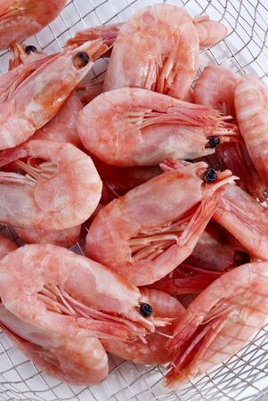 fresh shrimp after cooking in a sieve photo