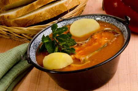 Hungarian fish soup with potato and bread
