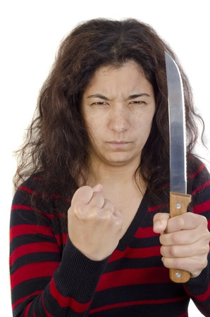 aggressive young woman with a clenched fist and a large kitchen knife Stock Photo - 13320388