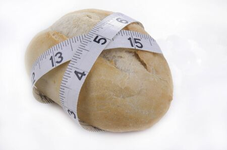 inch: home baked roll with inch measuring tape