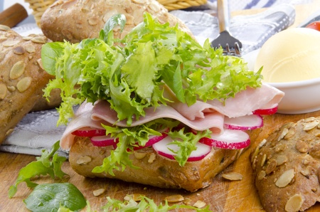 sunflower seed roll with oven baked ham and sliced radish Stock Photo - 13515751