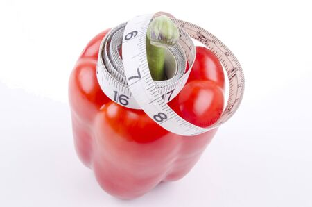 inch: red bell pepper with inch measuring tape
