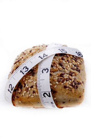 inch: multigrain roll with inch measuring tape