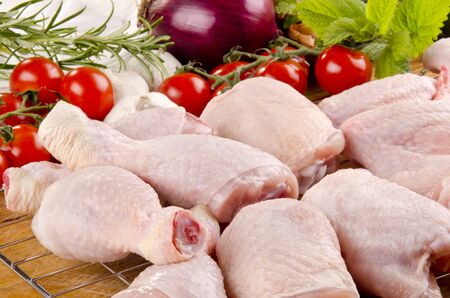 bbq chicken: poultry parts before preparation and vegetable Stock Photo