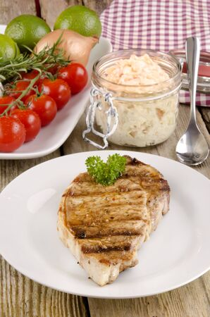 grilled loin steak on a plate and some coleslaw Stock Photo - 13811088