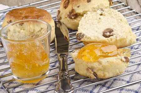 european rowan: home made rowan jelly in a glass and raisins buns