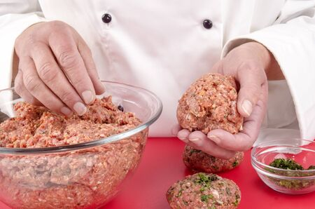 minced meat and chopped herbs to make meat balls photo