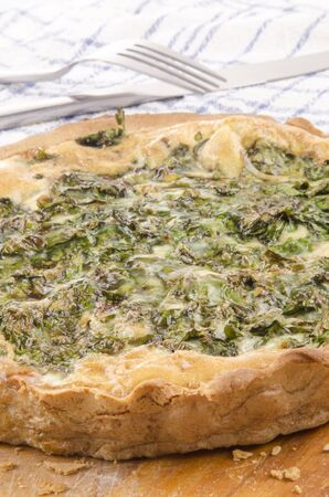 freshly baked spinach quiche on a wooden board Stock Photo - 15060209