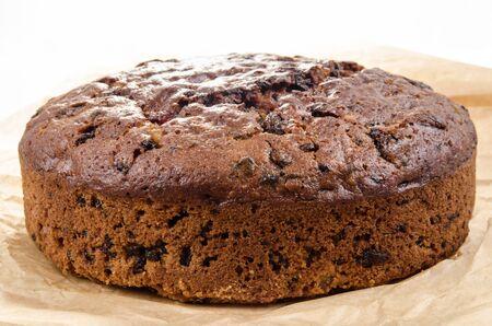 traditon: freshly baked Christmas fruit cake on baking paper