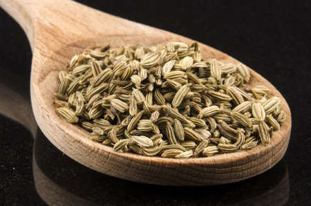 caraway seeds on a wooden spoon photo