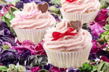 valentine cupcake with chocolate heart and red bow photo