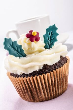 buttercream: chocolate cup cake with  buttercream and flower