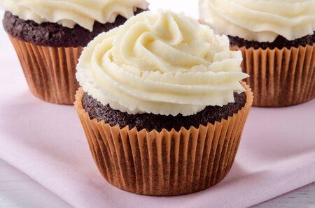 buttercream: chocolate cupcake with vanilla buttercream on a pink napkin