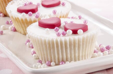 vanilla cupcake: vanilla cupcake with pink and white pearls