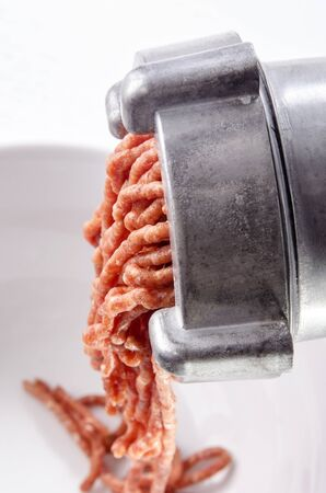 pork minced meat comes from a mincer Stock Photo - 16751787