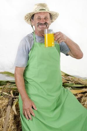 organic farmer is holding a big glass orange juice photo