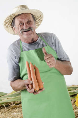 farmer with organic carrots in his hand photo