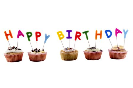 happy birthday cupcake with candles and white background Stock Photo - 17098148